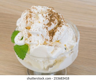 Ice cream with cinamon and mint leaves