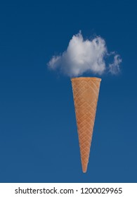 Ice cream cone with blue sky and cloud. Dream holiday, vacation concept.