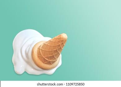 Ice cream cone fallen on blue vintage background.