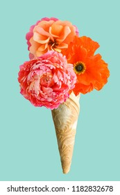Ice cream cone filled with handmade crepe paper flowers isolated on pink background