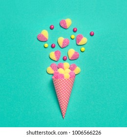 Ice Cream Cone with Gummy Candies. Flat lay. Love,Valentines day concept. Summer Party, Birthday Firework background. Bright Sweet Color. Trendy fashion Style. Minimal. Art.