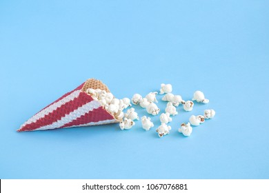 Ice cream cone with popcorn isolated on pastel blue background minimal creative concept.