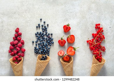 Ice cream cones with fruits. Fresh berry fruit, top view of strawberry, blueberry, raspberry and currant