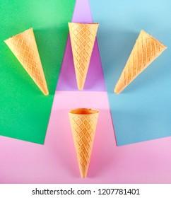 Ice cream cones over multi color background