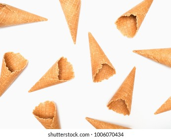Ice cream cones pattern. Empty wafer ice cream cone on a white background. Sweet summer concept. Flat lay, top view