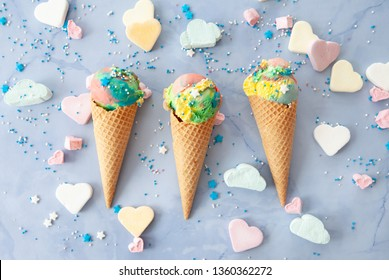 Ice cream cones in rainbow colors with colorful candy