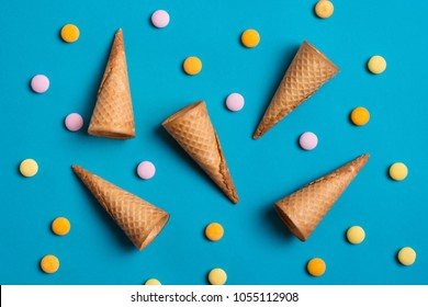 Ice cream cones and sweets over blue background.