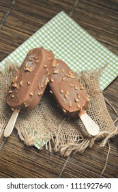 Ice cream covered with chocolate and almonds sticks
