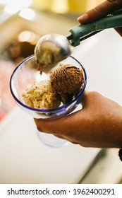 Ice cream (derived from earlier iced cream or cream ice) is a sweetened frozen food typically eaten as a snack or dessert. It may be made from dairy milk or cream and is flavoured with a sweetener, ei - Shutterstock ID 1962400291