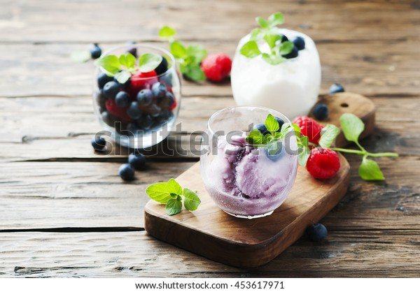 Ice cream with fresh berry and mint, selective focus