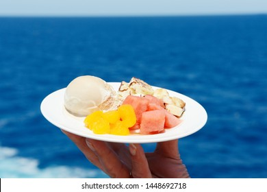 ice cream and fruits in front of ocean