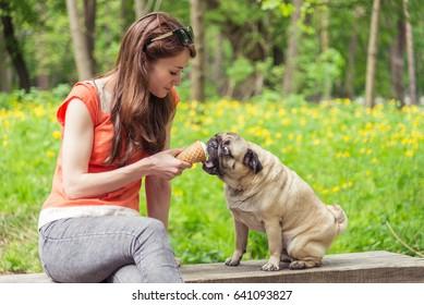 Ice cream. The girl is feeding the dog ice cream