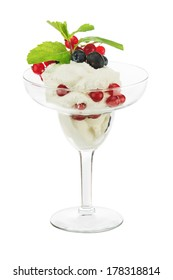 Ice cream in glass bowl with fruits isolated on white background. Closeup.