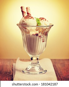 Ice cream in the glass on the table. Vintage retro hipster style version