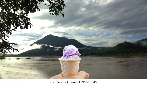 Ice cream in hand, natural background