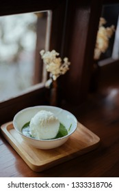 Ice cream with matcha on the wood table, look like japanese style.