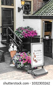 an ice cream parlour with beautiful plants in the courtyard