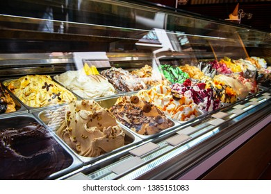 Ice cream in Rome, Italy. Italian gelateria. Ice-cream cafe, show window with sweeties.