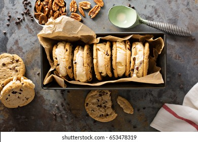 Ice cream sandwiches with nuts and caramel and chocolate chip cookies overhead shot