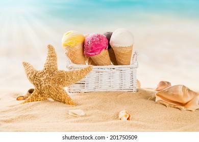 Ice cream scoops on sandy beach, close-up.
