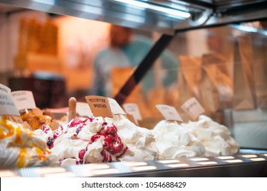 Ice cream in showcase fridge at confectionery shop