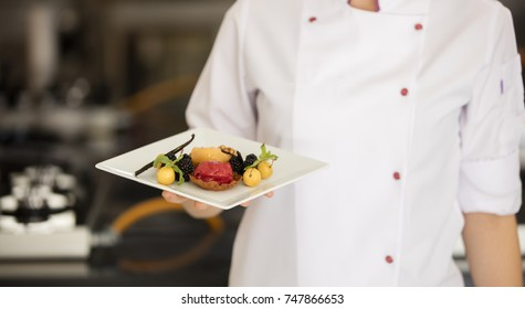 ice cream sorbe on plate at waiters hand
