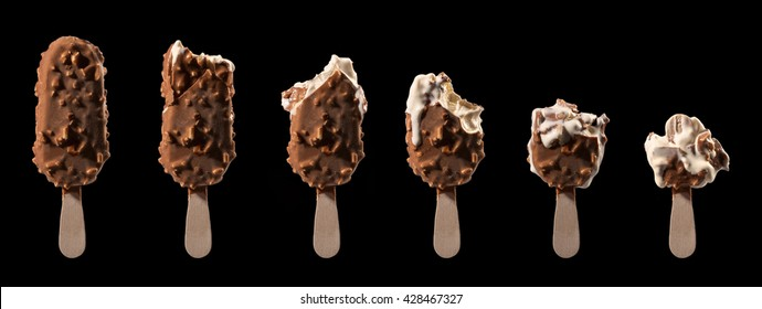 ice cream stick chocolate vanilla and almonds isolated on black