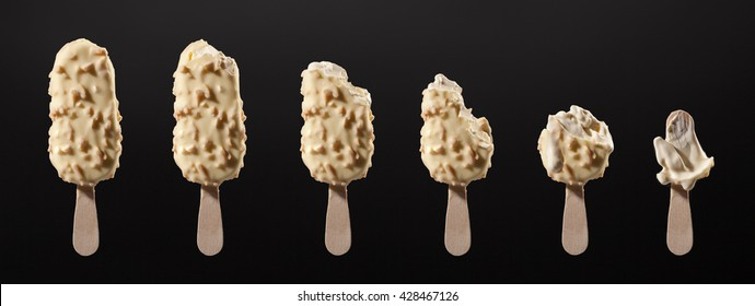 ice cream stick white chocolate vanilla and almonds isolated on black
