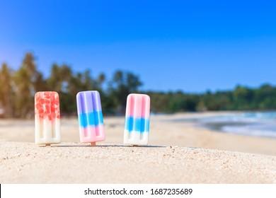 ice cream sticks in the sand on the beach at Phuket , Thailand