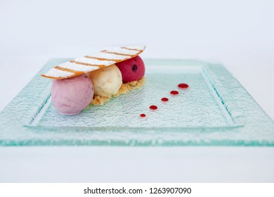 Ice cream with a surf board wafer on a glass plate