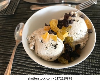 ice cream with topping in a small bowl