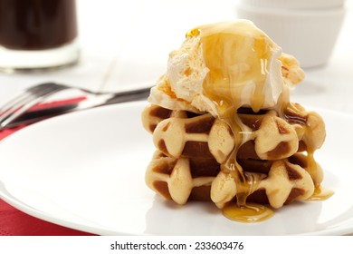 Ice cream and waffle dessert with syrup