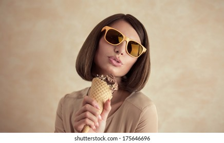 Ice cream woman singing in cone like in microphone happy, joyful and cheerful. Cute young female model eating ice cream cone