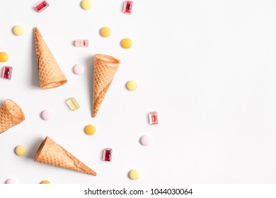 Ice crean cones and candy lay flat image with copy space