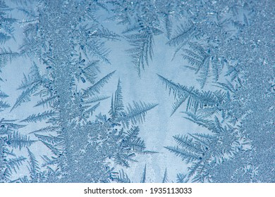 Ice crystals in the detail on a window glass in winter time