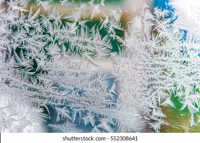 Ice crystals on the surface of the window, winter background