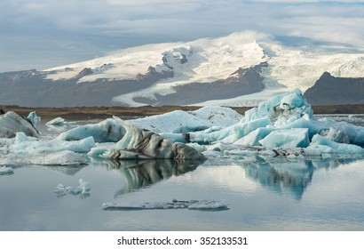 Ice cube and iceberg at Jokulsarlon glacial lagoon with snow mountain background