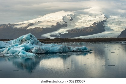 Ice cube and iceberg at Jokulsarlon glacial lagoon with snow mountain background