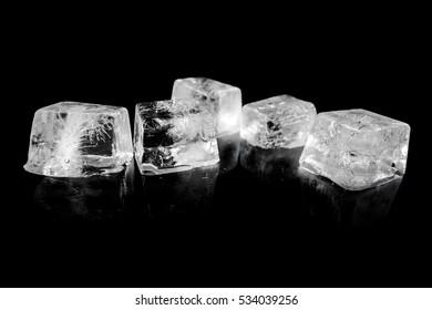 Ice cube on black background