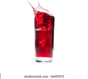 An ice cube splashes into cold cranberry juice