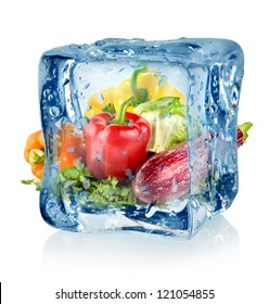 Ice cube and vegetables isolated on a white background