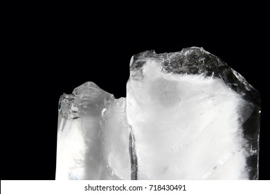 Ice cube / Ice is water frozen into a solid state. Depending on the presence of impurities such as particles of soil or bubbles of air, it can appear transparent