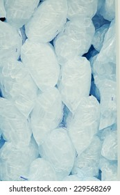 Ice cubes in blue plastic bags
