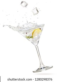 ice cubes falling into a gin martini cocktail splashing on white background