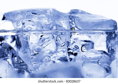Ice cubes in the glass of water.