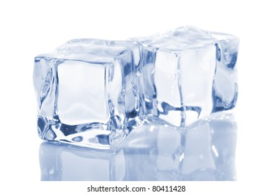 Ice cubes isolated on a white reflecting table