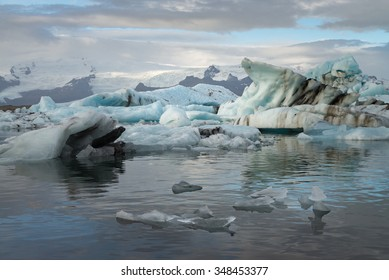 Ice cubes at  Jokulsarlon Glacier Lagoon with snow mountain background
