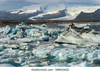 Ice cubes at  Jokulsarlon Glacier Lagoon with snow mountain range background