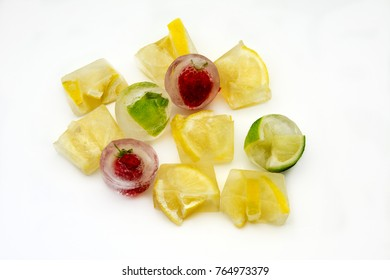 Ice cubes with lemons and frozen strawberries