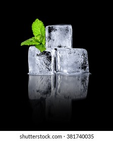 Ice cubes with mint green on a black background .